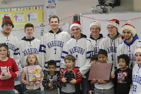 Senior Hockey Players Give Gifts to Mrs. Schoen's 15:1:1 Class