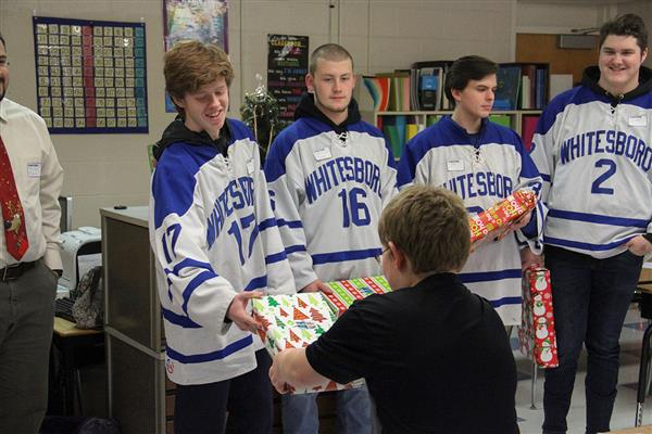 Varsity Hockey Players Hand Out Gifts at Westmoreland Road Elementary School