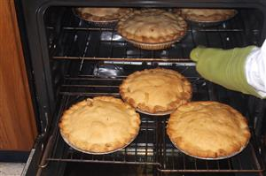 pies in oven