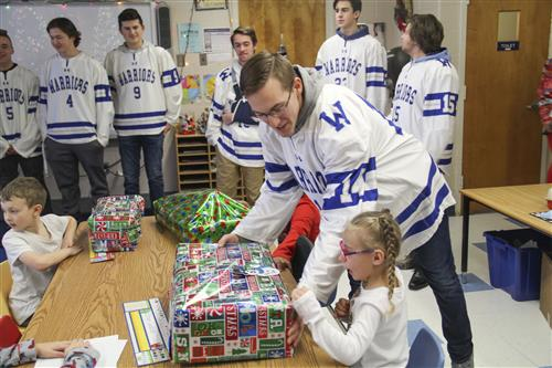 Senior Hockey Players Continue Tradition of Giving Gifts to Westmoreland Road Elementary Class