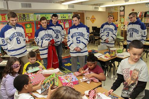 hockey team passing out gifts