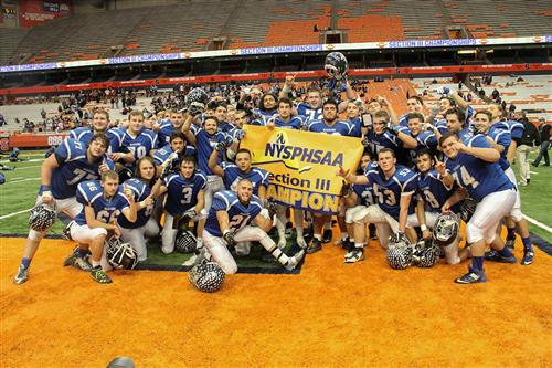 Team photo with Section III championship banner
